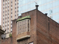 Bay Window old location R O Blechmans The Ink Tank 5589 (Brechtbug) Tags: 2019 bay window new york back building viewed from 46th street industrial looking with television antenna tv roof aerial fire escape 2 west 47th nyc the large leaded glass is former location r o blechmans ink tank a wonderful important animationdesign studio that produced work 1977 2004 it was architecture cram goodhue ferguson who designed st thomas bartholomew churches