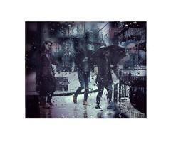The shine. (michaelackroyd) Tags: street rain people raindrops