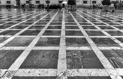 (cherco) Tags: water rain umbrella city granada spain man lonely alone light lines vanishingpoint loner architecture arquitectura aloner composition canon solitario solitary silhouette silueta street urban mojado monochrome blackandwhite adoquinado