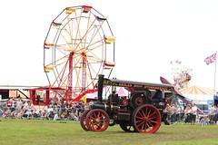 Ferris Wheel and the Traction Engine (Paul Brunt) Tags: ferriswheel ferris wheel maroon red traction engine tractionengine cromfordsteamrally steamrally steam rally derbyshire england unitedkingdom