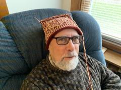 Ali modeling Catherine's latest hat project in progress, Photo by CRudin (ali eminov) Tags: wayne nebraska hats handknithats ali