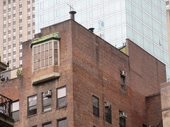 Bay Window old location R O Blechmans The Ink Tank 5591 (Brechtbug) Tags: 2019 bay window new york back building viewed from 46th street industrial looking with television antenna tv roof aerial fire escape 2 west 47th nyc the large leaded glass is former location r o blechmans ink tank a wonderful important animationdesign studio that produced work 1977 2004 it was architecture cram goodhue ferguson who designed st thomas bartholomew churches