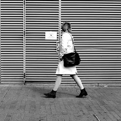 In front of the little poster (pascalcolin1) Tags: paris13 femme woman mur wall rayé lined affiches poster sac bag photoderue streetview urbanarte noiretblanc blackandwhite photopascalcolin 50mm canon50mm canon