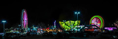 distractions along the highway (pbo31) Tags: bayarea california nikon d810 color october 2019 boury pbo31 autumn hayward eastbay alamedacounty night black spinning butler amusements carnival rides lightstream motion parking lot mall panoramic large stitched panorama