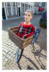 The lady vanishes (leo.roos) Tags: manikin dummy doll pop mannequin etalagepop paspop bicycle bike trui cardigan red zeeland zierikzee nl rood fiets reclame a7rii venusopticslaowa15mmf4widemacro laowa154 darosa leoroos