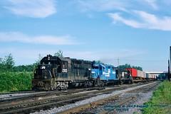 CR 2303-3665-2684, Selkirk, NY. 7-15-1977 (jackdk) Tags: train railroad railway locomotive emd emdgp35 gp35 cr conrail selkirk selkirkny standardcab tofc trailertrain tv16 ge gelocomotive geu25b u25b penncentral pc fallenflag sta