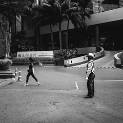 On duty. (Andy @ Pang Ket Vui ( shootx2 )) Tags: duty security guard bangkok hotel amari black white street photography fujifilm x100f