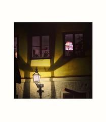 Turn on  the  light... (martha ander) Tags: light lantern yellow night wall shadows house pink