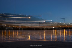 blue hour at paremata bridge with light trails and camera movement (hueymilunz) Tags: nz newzealandtransition newzealand longexposure blue landscape wellington kapiti night light dark water