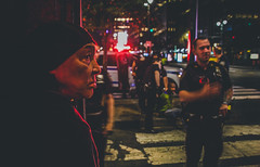 Things Are Not Always Black And White (Creekside Photog) Tags: midtown newyork cops police arrest street night red lights