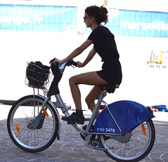 Tourist in Marseille (thomasgorman1) Tags: tourist marseille port street streeshots nikon cyclist bicyclist rider woman travel bike rental streetshots candid riding outdoors