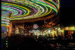 Carousel (Thanathip Moolvong) Tags: nikon fe 50mm f14 fujichrome velvia 100 reversal film carousel spin night people longexposure