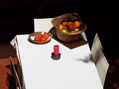 Waiting for Judas (Matteo Allochis) Tags: table white cloth candle orange tomato apple terrace firenze wicker basket fruits sunny spring shadow