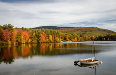 The lone boat (Rabican7) Tags: newengland newhampshire fallfoliage colors forest woods foliage lake water cunninghampond boat sky reflection trees clouds calmness colorful autumn fall landscape scenery