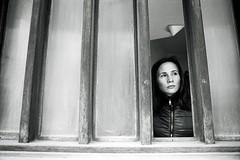 The girl in the window (mozo273) Tags: city portrait urban woman window girl analog 35mm canon diy kodak snapshot cyprus 135 eos30 oldtown limassol xtol filmphotography fomapan selfdevelopment fomafilm blackandwhite bw monochrome bnw