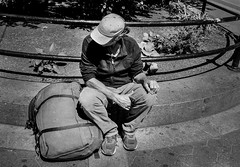 Passing through (Nun Nicer Artist) Tags: 35mmstreetphotography 35mm manhattan monochrome travel traveler blackandwhite streetphotography sitting resting hitchhiking newyork nunnicer analogfilm analog urban