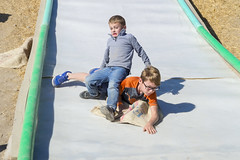 Sweeping Legs on a Crowded Slide (aaronrhawkins) Tags: slide surprise kids boys children slippery plastic hill mound gunnysack autumn harvest festival play playground accident sweep legs fall slip surface heehawfarms homemade crowded exit trip aaronhawkins joshua