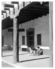 4x5-095p-58 (ndpa / s. lundeen, archivist) Tags: nick dewolf nickdewolf bw blackwhite photographbynickdewolf newmexico southwest southwestern west western us unitedstates high desert santafe town village city adobe building architecture plaza local people woman women vendor vendors historic palaceofthegovernors ballustrade museum museumofnewmexico sign signs nativeamerican nativeamericans indian indians jewelry trinkets schoolofamericanresearchofthearchaeologicalinstituteofamerica 1957 1950s film monochrome blackandwhite southwesternunitedstates 4x5 largeformat positive late1950s sheetfilm