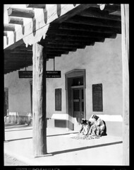 4x5-094-58 (ndpa / s. lundeen, archivist) Tags: nick bw newmexico southwest west us blackwhite unitedstates western southwestern dewolf nickdewolf photographbynickdewolf plaza city people woman santafe building architecture town high women village desert adobe vendor local signs sign museum indian jewelry historic nativeamerican indians nativeamericans trinkets palaceofthegovernors vendors ballustrade museumofnewmexico blackandwhite film monochrome 1950s 1957 4x5 largeformat southwesternunitedstates schoolofamericanresearchofthearchaeologicalinstituteofamerica late1950s sheetfilm