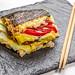 Sushi Burger on black background with chopsticks