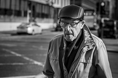 Capped (Leanne Boulton) Tags: urban street candid portrait portraiture streetphotography candidstreetphotography candidportrait streetportrait eyecontact candideyecontact streetlife old elderly man male face eyes expression mood emotion feeling glasses cap leather scarf autumn winter sunlight tone texture detail depthoffield bokeh naturallight outdoor light shade shadow city scene human life living humanity society culture lifestyle people canon canon5dmkiii 70mm ef2470mmf28liiusm black white blackwhite bw mono blackandwhite monochrome glasgow scotland uk