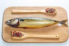 Whole smoked mackerel on a wooden kitchen Board with a mix of peppers. Top view (wuestenigel) Tags: spoon seafood smoked wooden fish mediterranean background dinner mackerel pepperpeas delicious healthy meal cuisine snack lunch kitchenboard nutrition fresh spices food white fisch wood holz noperson keineperson cooking kochen desktop hölzern meeresfrüchte essen ernährung traditional traditionell abendessen knife messer isolate isolieren nature natur board tafel köstlich trout forelle isolated isoliert makrele whole ganze 2019 2020 2021 2022 2023 2024 2025 2026 2027