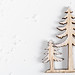 Wooden figures of a large and small Christmas tree on a white background with snow. Top view