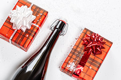 Top view a bottle of champagne and two gift boxes. The concept of Christmas (wuestenigel) Tags: bottle background festive gift card winter banner snowflake design cold time holiday xmas christmas surprise red champagne merrychristmas advent symbol newyear alcohol bow celebration packed decoration year merry snow eve box white weihnachten noperson keineperson desktop geschenk bogen feier dekoration color farbe paper papier thread faden birthday geburtstag art kunst wood holz stilllife stillleben 2019 2020 2021 2022 2023 2024 2025 2026 2027 2028 2029 2039