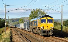 Dewsbury Stone At Eastburn. (Neil Harvey 156) Tags: railway 66744 crossrail eastburnfootcrossing eastburn silsden airevalley stonetrain 6d28 class66 gbrf