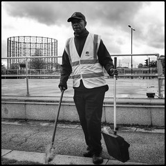 On The Job (NickD71) Tags: fuji fujifilm xt1 csc mirrorless compact system camera advanced snapseed mono monochrome street people daily life candid greenwich peninsula london uk xf1855 cleaning council worker work gas tower brush broom