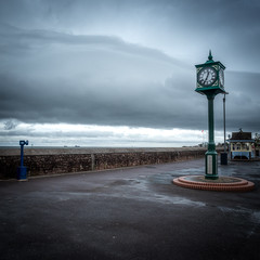 Empty Prom (Mandy Willard) Tags: seafront beach seaside wall ships clock shelter wet