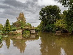Warwick castle. (S.K.1963) Tags: warwick castle river water reflections arch sky clouds trees bench olympus omd em1 mkii 1240mm 28