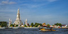 Wat Arun temple with river and transportation boat in Bangkok city (anekphoto) Tags: holiday buddha blue morning day transportation bangkok thailand church space sky chaopraya palace ship river chao asian prang pagoda temple arun wat transport tourist art cityscape travel religion stupa boat buddhism asia architecture landmark tourism dawn culture attraction traditional ancient thai tower beautiful chedi city religious sunset water night phraya