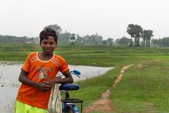 (Karunyaraj) Tags: boy india rurallife potrait bokeh silkybokeh village cycle transport smile environmentpotrait kid kidspotrait children childhood water nikon24120 d610 cwc cwc742