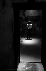 (Luther Roseman Dease, II) Tags: light woman room shadows monochrome human atmosphere mood space framing depth experimental