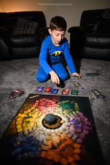 Atmosfear (Steven Robinson Pictures) Tags: atmosfeargame atmosfear atmosphere game boardgame home domesticlife cute boy playing fun livingroom nikond850 24mmf14g vertical environmentalportrait carpet cards light offcameraflash hardlight halloween scarygame batmanpj