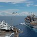USS Ronald Reagan (CVN 76) approaches USNS Carl Brashear (T-AKE 7) to perform a replenishment-at-sea