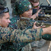 A U.S. Marine shares his knowledge of M40A6 sniper rifle with a Philippine Marine during KAMANDAG 3
