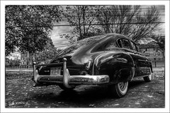 Four Door Fastback (* Gemini-6 * (on&off)) Tags: hdr framed chevy chevrolet chrome reflection clouds sky blackandwhite monochrome wideangle lowangle automobile vehicle transportation