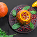 Top view Halloween concept-pumpkin with pumpkin puree, spinach and pomegranate on black background