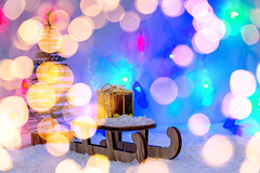 A sledge with a gift in the snow with a blurred background of glowing lights (wuestenigel) Tags: banner snowflake abstract xmas christmas snow merrychristmas advent festive celebration golden design merry shine blurred bokeh garland winter gift eve holiday cold lights packed newyear box symbol white decoration card surprise bow wooden background year 2019 2020 2021 2022 2023 2024 2025 2026 2027 2028 2029 2039
