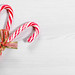 Christmas candy canes on a white wooden background