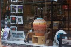 Southwest Vase (LensAdventurer) Tags: sonynex5n manitousprings colorado vase southwestart zeiss jena tessar 5028 window shop