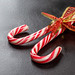 Christmas candy canes on a black background