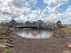 ... (Jean S..) Tags: building boutique store pond sky clouds stone bridge island white blue