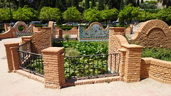 Brick Feature and Pond With Lily Pads, Jardines de Pedro Luis Alonso, Málaga, Costa del Sol, Andalusia, Spain (dannymfoster) Tags: spain andalusia andalucia costadelsol malaga jardinesdepedroluisalonso brick pond lilypad