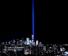 """Tribute in Light"" with Freedom Tower (StephenLeedyPhotography) Tags: night new york city manhattan searchlight skyline freedom tower statue liberty landscape light blue tribute tributeinlight"