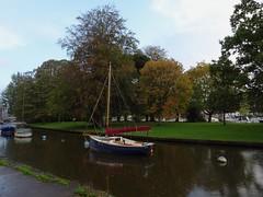 In a seasonal shower (Phil Gayton) Tags: water boat grass tree autumn fall abscission mill tail vire island river dart totnes devon uk