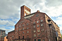 Old mill building by the canal at Chester (Tony Worrall) Tags: north update place location uk england visit area attraction open stream tour country item greatbritain britain english british gb capture buy stock sell sale outside outdoors caught photo shoot shot picture captured ilobsterit instragram canal warehouse mill chimney brick relic tall apartments chester cheshire old past saved sign ghostsign architecture building
