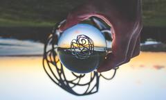 3079 (saul gm) Tags: reflected reflection ocean sea cantábrico coastline sky idyllic steel art sculpture travel europeanunion europe spain asturias gijón landscape dusk sunset meadow spheric sphere ball glass crystal hand